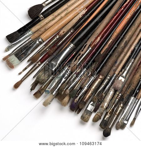 bunch of painting brushes on white