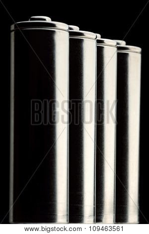 four AA batteries - shallow depth of field - focus on the second battery
