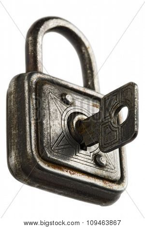 a vintage padlock with a key on white