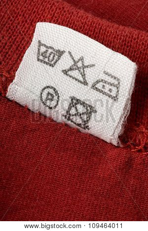 a washing instruction tag on a red t-shirt