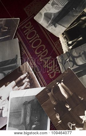vintage photographs on an old photo album