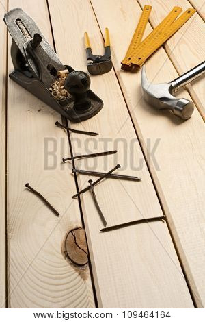 a carpenter's tools on wood boards