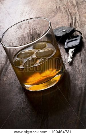 (don't) drink and drive -  glass of liquor and car keys on a bar