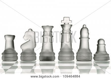 glass chess pieces on a glass board against white
