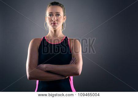 Focused Athletic Blond Woman Wearing Tank Top