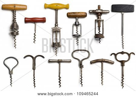 a collection of dozen vintage corkscrews on white