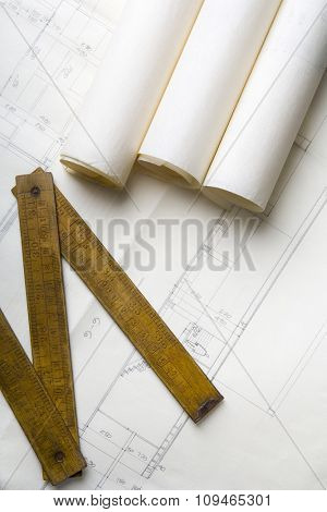 architecture plans and a carpenter's meter