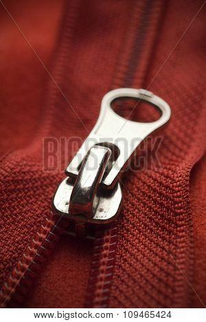 closeup of a red zipper
