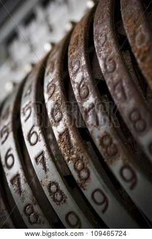 a detail of an old and rusty cash register