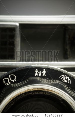 closeup of focusing symbols on an old camera lens