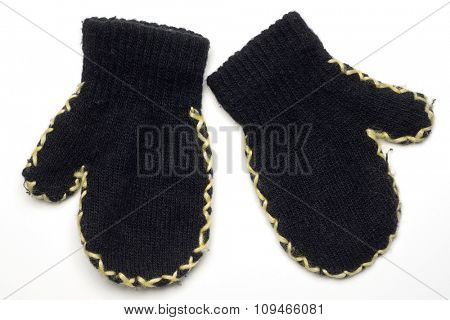 a pair of black wool child's mittens on white