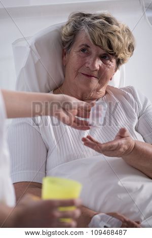 Ill Woman Taking Medicines