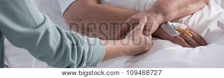 Female Holding Cancer Patient Hand