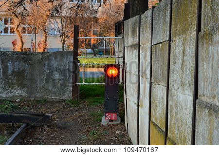 A red light train signal in the city