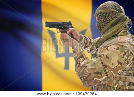 Male With Gun In Hand And National Flag On Background - Barbados