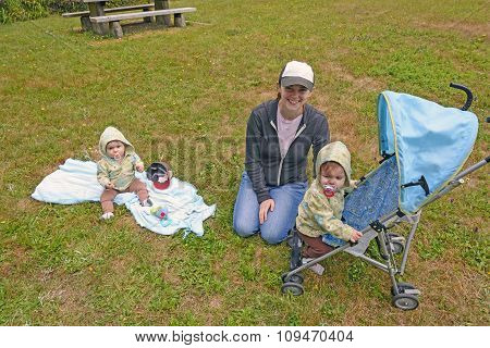 Mom Watching Her Twins In The Park