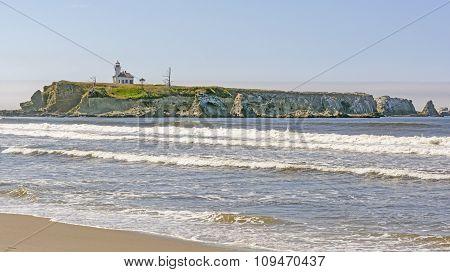 Lighthouse On A Remote Rocky Coast