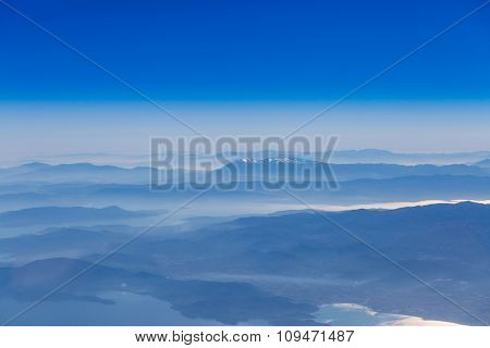 Deep blue sky above landscape with mountains and sea,atmospheric aerial photography
