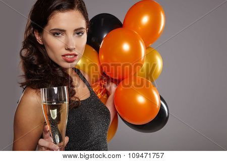 Celebrating Woman. Holiday People. Beautiful Girl with Holiday Makeup Holding Glass of Champagne