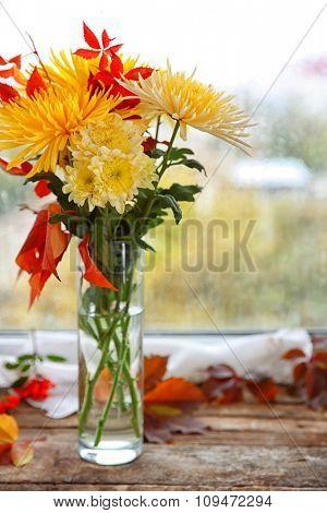 Beautiful autumn bouquet with chrysanthemums flowers, on windowsill