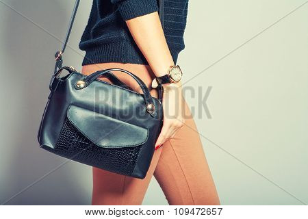 beautiful young woman posing with handbag and copy space