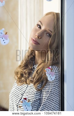Relaxed Girl At Window In Xmas Time