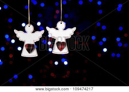 Wooden Angels On A Dark Background