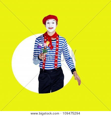 Smiling male mime with flowers.Funny actor in red beret, sailor suit poses on color background