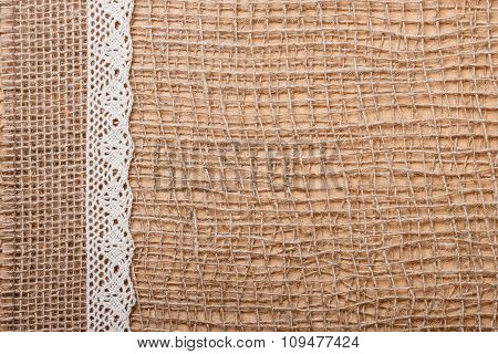 Lace Ribbon On Burlap Cloth Background