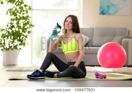 Beautiful young girl with fit ball at home