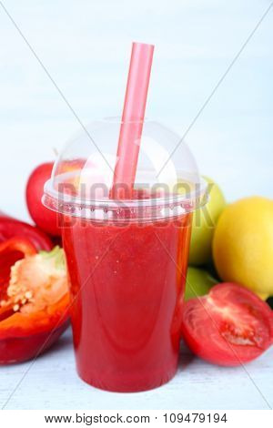 Fresh juice mix fruit and vegetables, healthy drink on wooden table, on light background