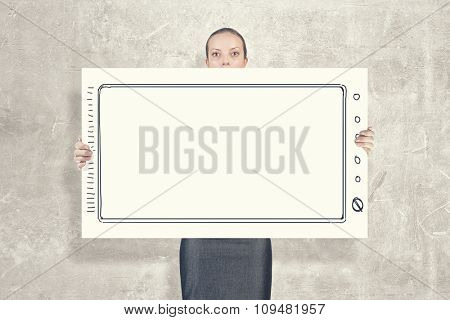 Young woman showing white blank banner. Place for text