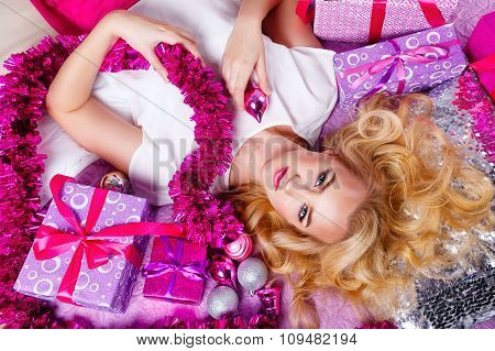 Girl Lying On The Couch. Around Gifts And Festive Tinsel.