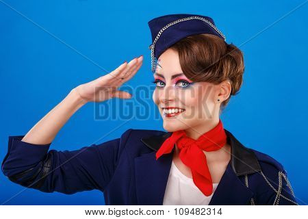 Stewardess With Face Art Salutes.
