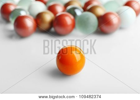 Orange ball opposite others, isolated on white, individuality concept