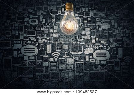 Glowing glass light bulb on computing concept background