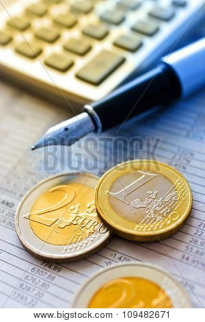 Euro Coins And Pocket Calculator
