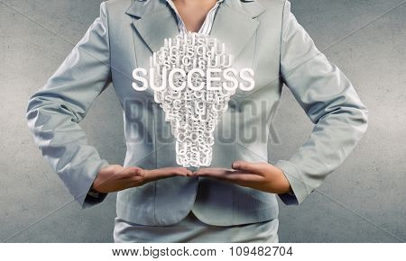 Businesswoman holding in hands successful idea concept