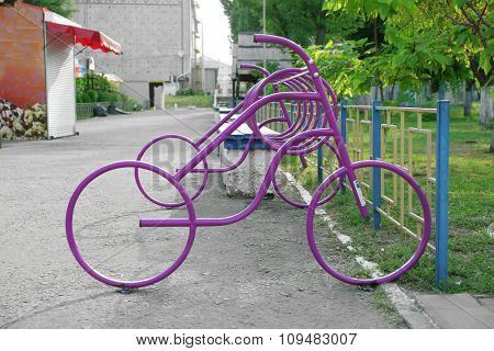 Purple iron bikes in park