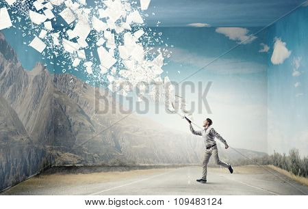 Young handsome man reaching hand with book