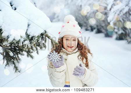 Laughing Girl With Snowflakes In His Hand, In Winter Park.