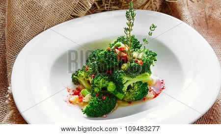 boiled broccoli in white bowl
