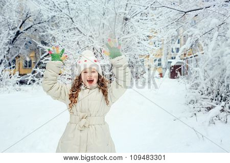 Laughing Girl With Happy Hand Up, In Winter Park.