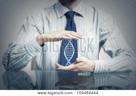 Hands of businessman holding with care molecule concept