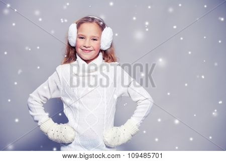 Girl in winter clothes. Happy child. Studio shot