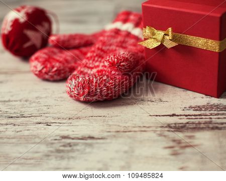 Gift with christmas ball on wood floor. Winter decoration
