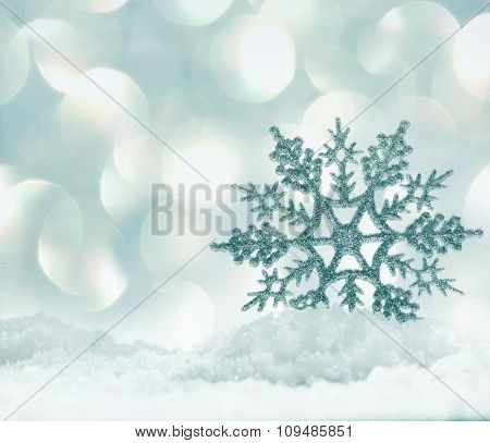 Christmas decoration. Christmas snowflake on snow