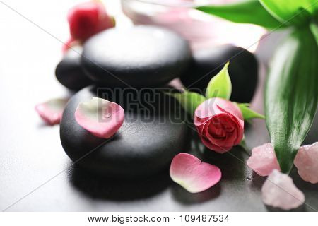 Spa composition of stones and flowers, closeup