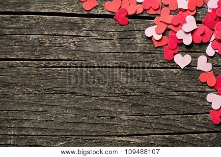 paper hearts on old wooden background
