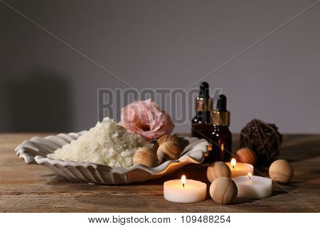 Beautiful spa composition on wooden table against grey background